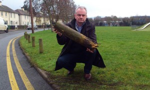 Jeremy Hilton holding one of the rotten bollards