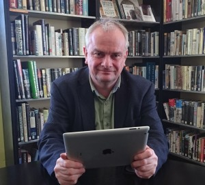 Jeremy Hilton ready to use his tablet computer at Gloucester Library