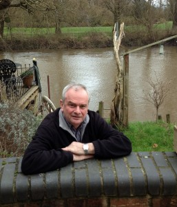 Jeremy Hilton behind the flood wall at Alney Terrace