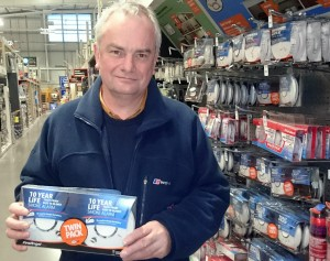 Jeremy Hilton holding easy to purchase and fit smoke alarms