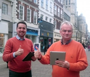 Lib Dem councillors Sebastian Field and Jeremy Hilton celebrate free wifi for Gloucester City Centre