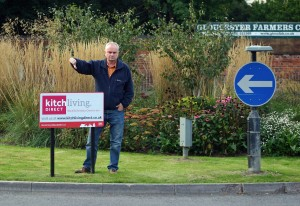 Jeremy Hilton gives a thumbs down to advertising on Tewkesbury Road roundabout