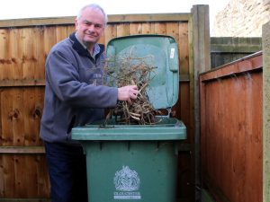 Jeremy Hilton with GCC garden waste bin subject to a 22% increase in collection charge